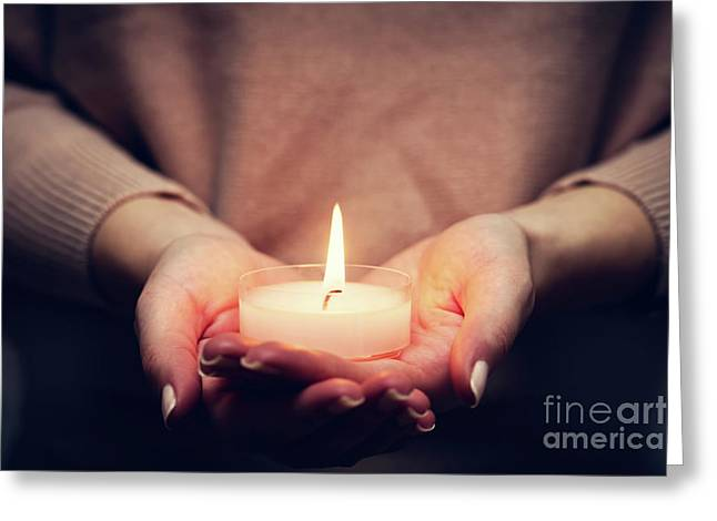 Candle Light Glowing In Woman's Hands. Praying, Faith, Religion Greeting Card by Michal Bednarek