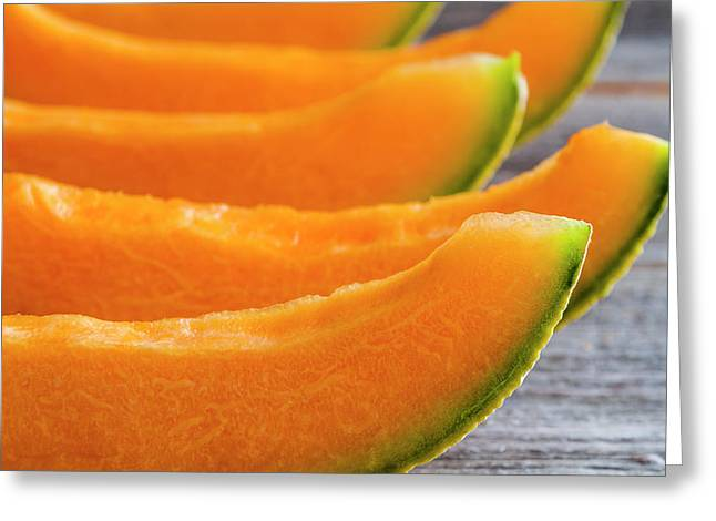 Cantaloupe In A Row Greeting Card by Teri Virbickis