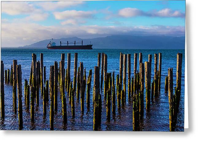 Cargo Ship And Old Pier Posts Greeting Card by Garry Gay
