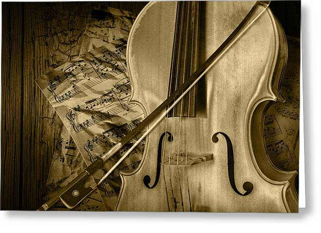 Cello Stringed Instrument With Sheet Music And Bow In Sepia Greeting Card by Randall Nyhof