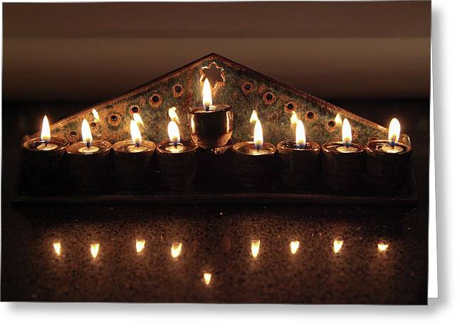 Ceramic Chanukkiah Lit With Eight Lights And One Lighter, The Shamash Greeting Card by Yoel Koskas