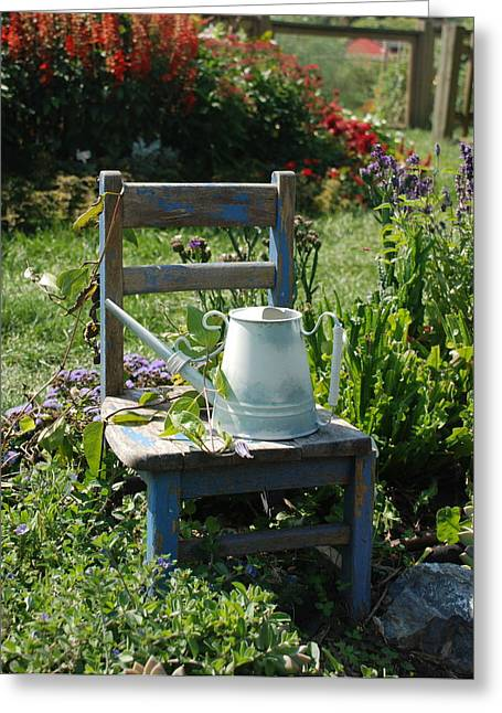 Chair And Watering Can Greeting Card by William Thomas
