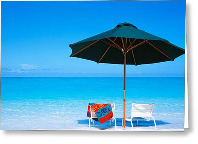 Chairs Under An Umbrella On The Beach Greeting Card