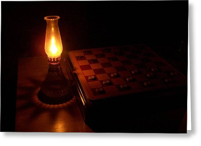 Checkers In The Dark Greeting Card by Katie Burris