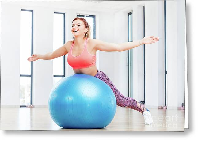Cheerful Woman Training With Fitball At Fitness Club. Greeting Card