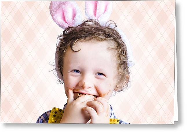 Child Eating Chocolate Easter Egg With Smile Greeting Card by Jorgo Photography - Wall Art Gallery
