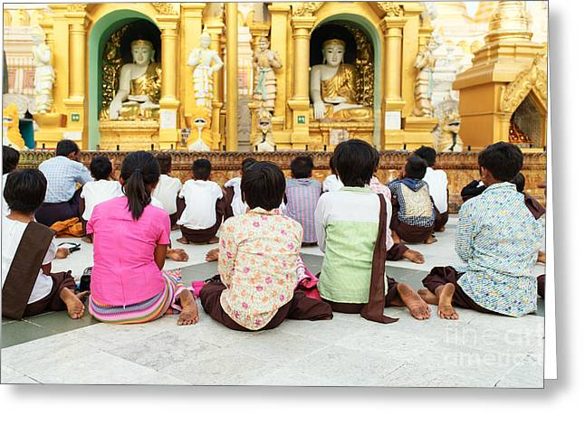 Greeting Card featuring the photograph Children Pray At Shwedagon Pagoda by Dean Harte
