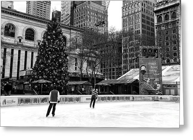 Christmas Ice Skating Greeting Card by John Rizzuto