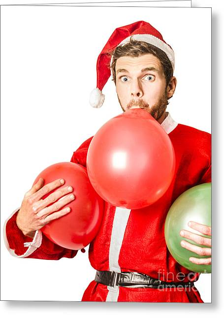 Christmas Party Planner Blowing Up Balloons Greeting Card by Jorgo Photography - Wall Art Gallery