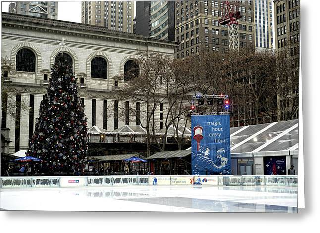 Christmastime In Bryant Park Greeting Card by John Rizzuto