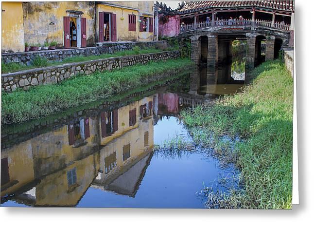 Greeting Card featuring the photograph Chua Cau Reflection by Hitendra SINKAR