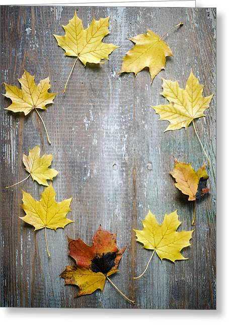 Circle Of Autumn Leaves On Weathered Wood Greeting Card