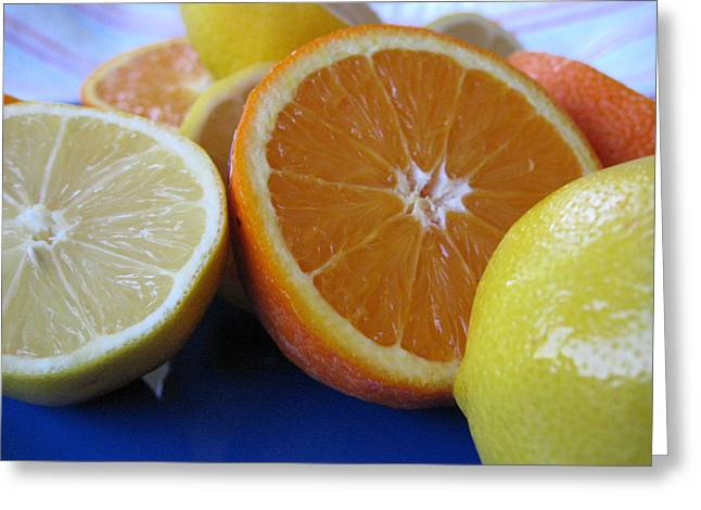 Greeting Card featuring the photograph Citrus On Blue Plate by Kim Pascu