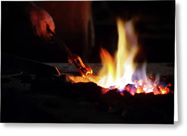 Close-up Of Hand  Heating Iron In Furnace Greeting Card