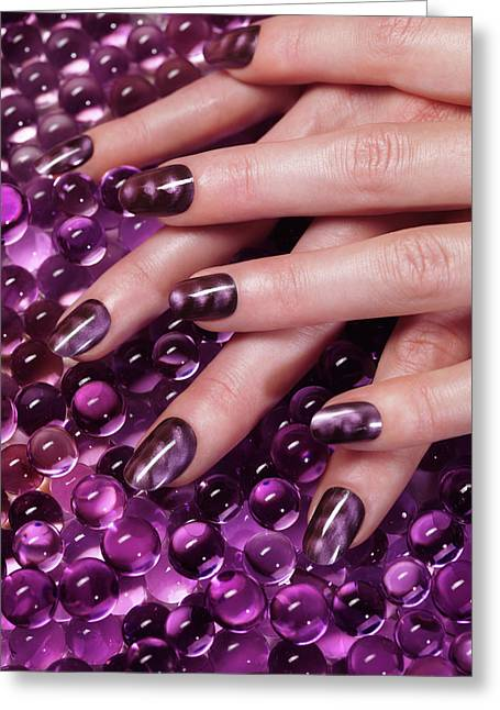 Closeup Of Woman Hands With Purple Nail Polish Greeting Card by Oleksiy Maksymenko