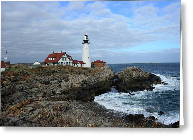 Clouds Over Portland Head Lighthouse Greeting Card by Lou Ford