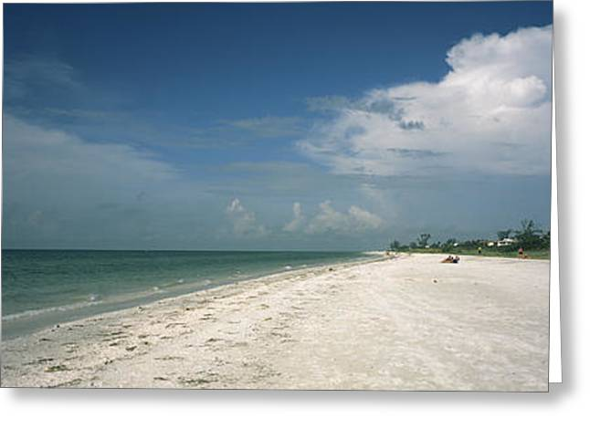 Clouds Over The Beach, Lighthouse Greeting Card by Panoramic Images
