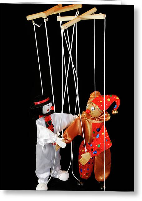 Clown Marionettes Shaking Hands On A Black Background With Suspe Greeting Card by Reimar Gaertner