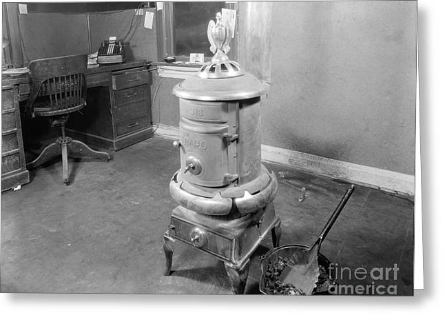 Coal Stove Heater In Business Office Greeting Card by H. Armstrong Roberts/ClassicStock
