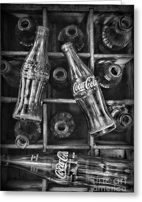 Glass Bottle Greeting Cards - Coca Cola Bottles in Black and White Greeting Card by Paul Ward