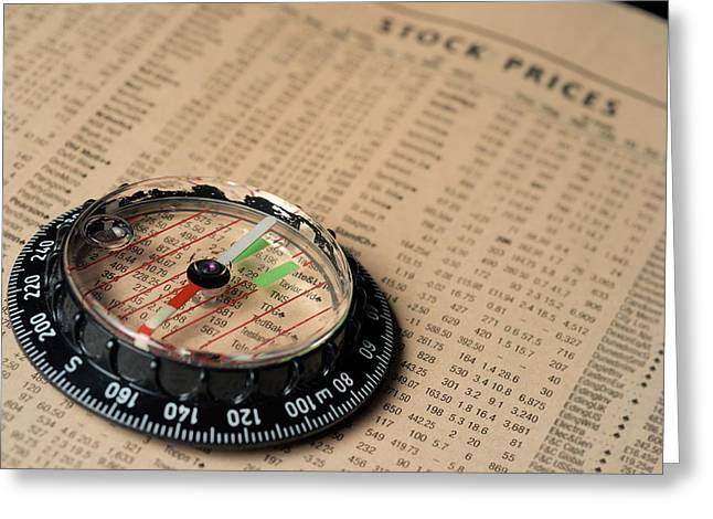 Information Greeting Cards - Compass on stockmarket cotation in newspaper Greeting Card by Sami Sarkis