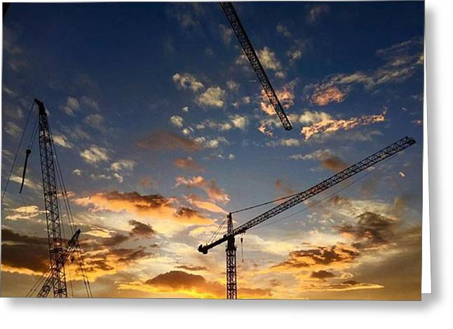 Construction Cranes At Sunset Greeting Card