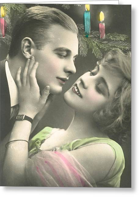 Couple About To Kiss In Front Of Christmas Tree Greeting Card