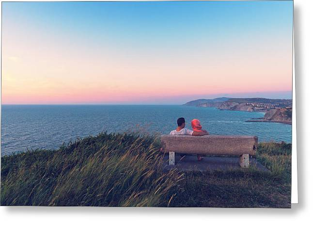 couple on bench vith view of Sopelana coast Greeting Card