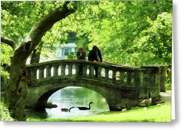 Couple On Bridge In Park Greeting Card