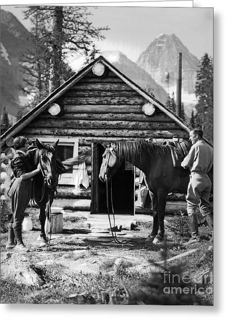 Couple Saddling Horses, C.1920s Greeting Card by H. Armstrong Roberts/ClassicStock