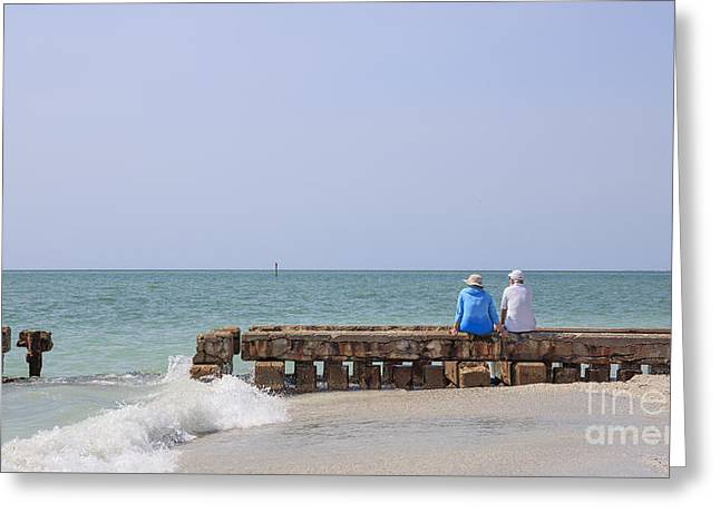 Couple Sitting On An Old Jetty Siesta Key Beach Florida Greeting Card by Edward Fielding