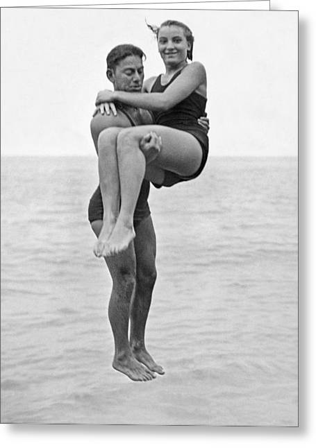 Couple Tandem Leaps Into Lake Greeting Card