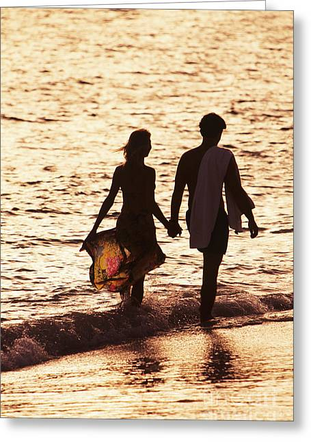 Couple Wading In Ocean Greeting Card by Larry Dale Gordon - Printscapes