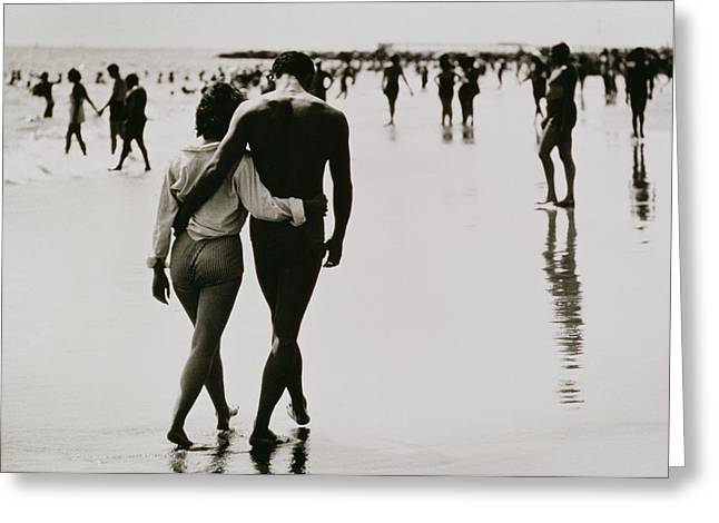 Couple Walking In The Water At Coney Island Greeting Card by Nat Herz
