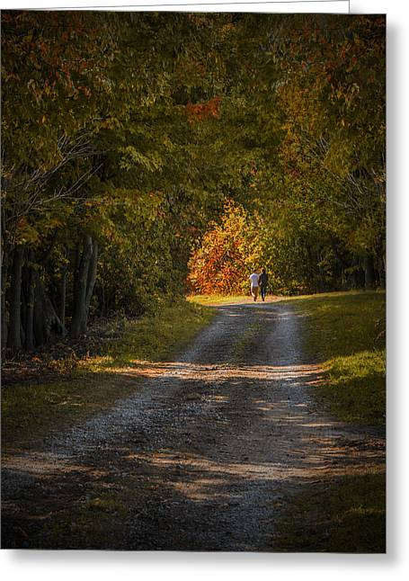 Couple Walking On A Dirt Road Through A Tree Canopy During Autumn Greeting Card