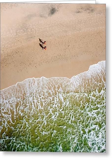 Greeting Card featuring the photograph Couple Walking On Tallow Beach by Rob Huntley