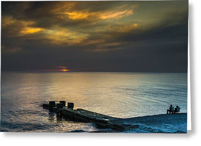 Couple Watching Sunset Greeting Card by John Williams