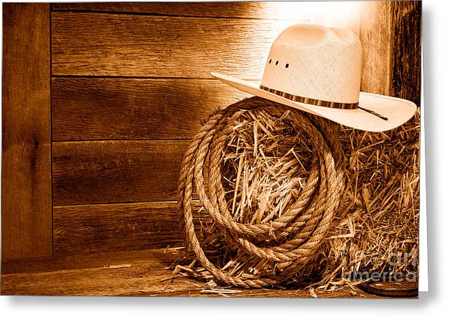 Cowboy Hat On Hay Bale - Sepia Greeting Card by Olivier Le Queinec
