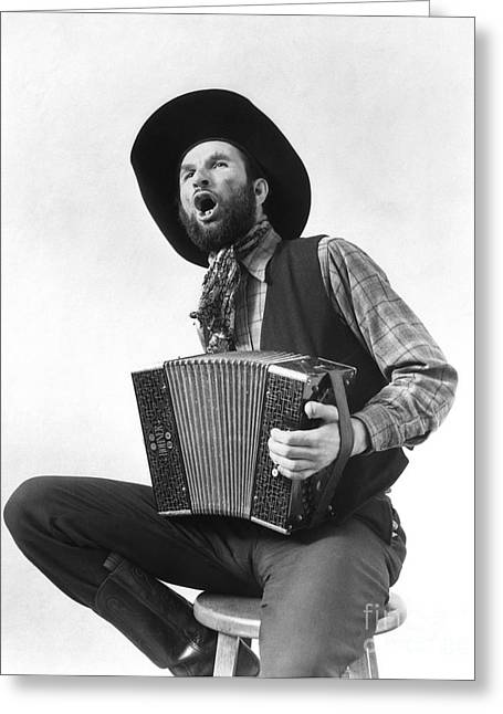Cowboy Playing Accordion And Singing Greeting Card by H. Armstrong Roberts/ClassicStock