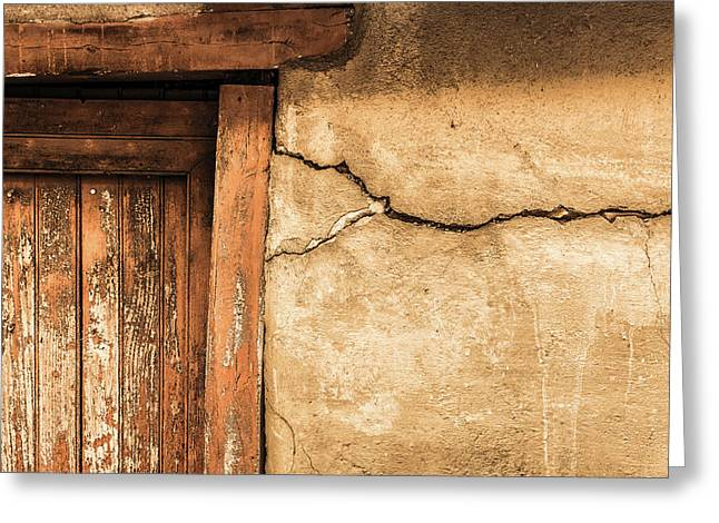 Greeting Card featuring the photograph Cracked Lime Stone Wall And Detail Of An Old Wooden Door by Semmick Photo