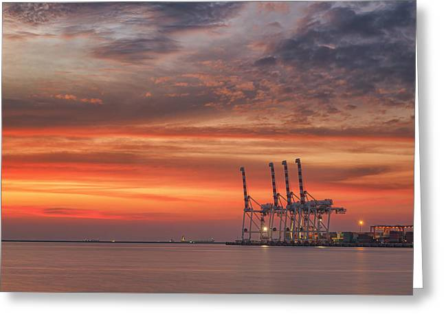 cranes and industrial cargo ships in Varna port at sunset Greeting Card