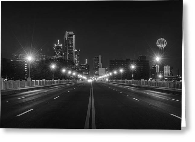 Greeting Card featuring the photograph Crossing The Bridge To Downtown Dallas At Night In Black And White by Todd Aaron