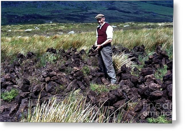Cutting Turf On The Comeragh Mountains Greeting Card by Joe Cashin