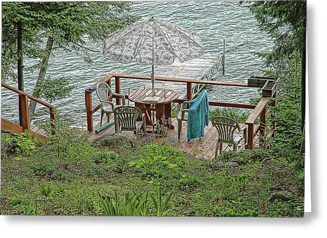 Deck At Blue Sea Lake Greeting Card by Ginette Thibault