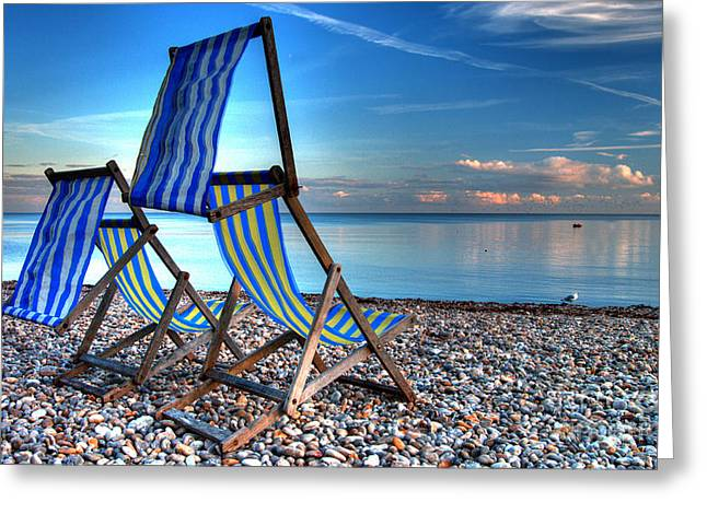 Deckchairs On The Shingle Greeting Card by Rob Hawkins