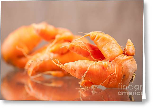 Deformed Carrot Roots With Forks Lying On Glass  Greeting Card by Arletta Cwalina