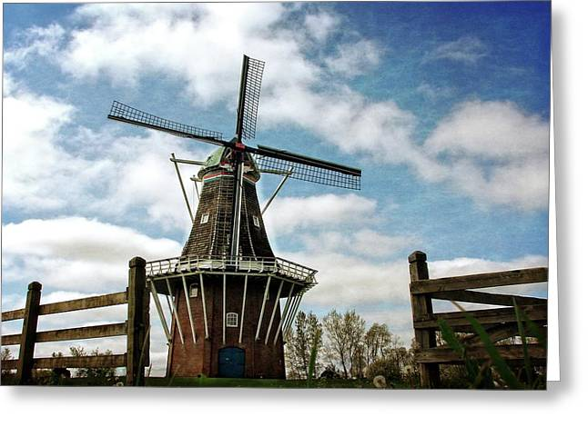 Greeting Card featuring the photograph Dezwaan Windmill With Fence And Clouds by Michelle Calkins
