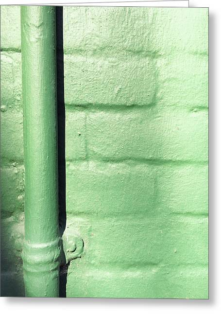Drainpipe On A Wall Greeting Card by Tom Gowanlock