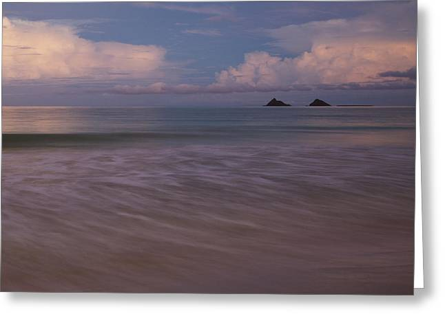 Greeting Card featuring the photograph Evening Glow Over Mokulua Islands by Charmian Vistaunet