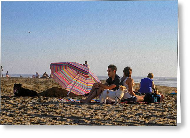 Family At Ocean Beach With Dogs Greeting Card
